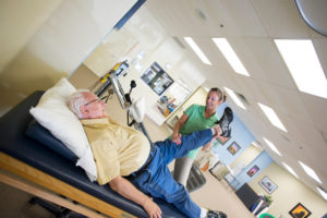 Physical Therapist in Manchester NJ stretching patient
