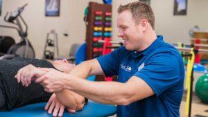 Oakhurst NJ Physical Therapist, Brad Czaszynski working with a patient