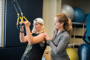 Physical Therapist, Sandy Neumann works with athlete